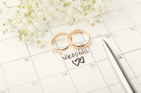Word wedding on calendar with sweet flowers